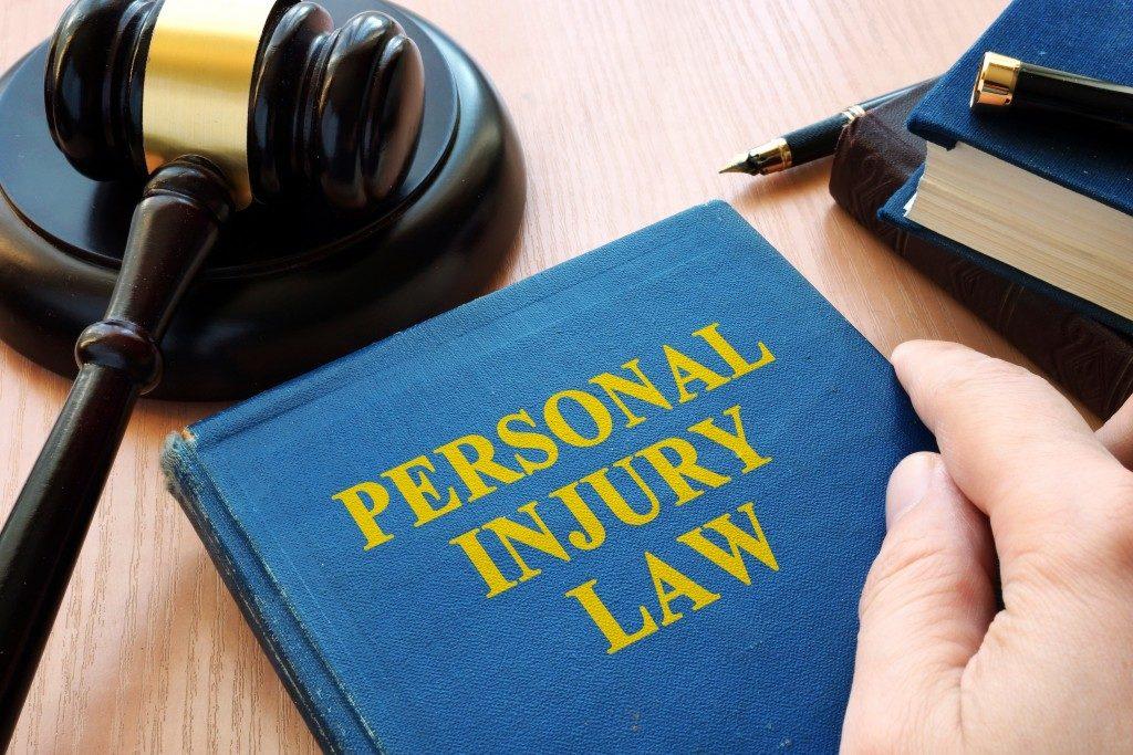 Personal injury law book beside gavel