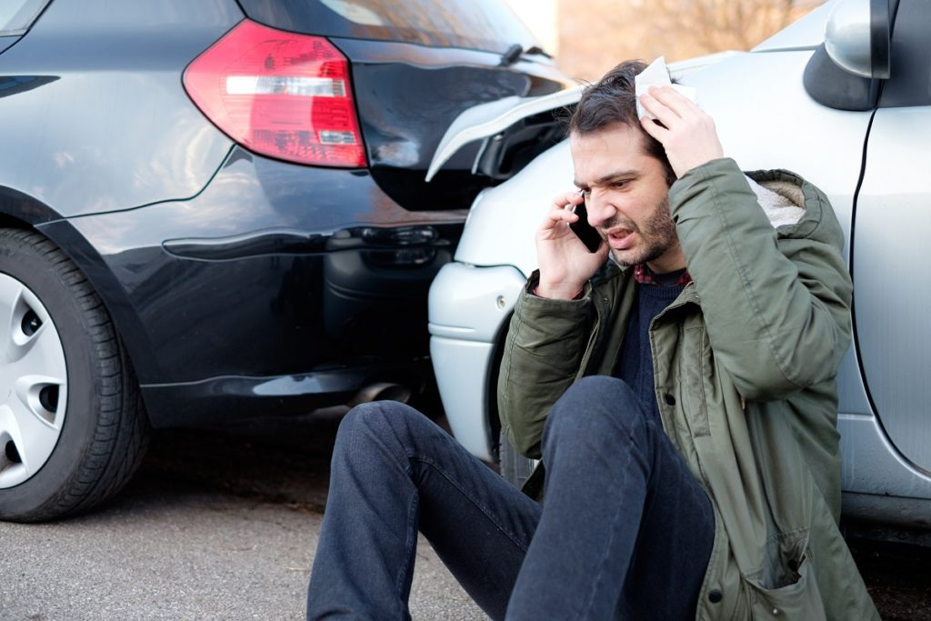man feeling stressed after car accident