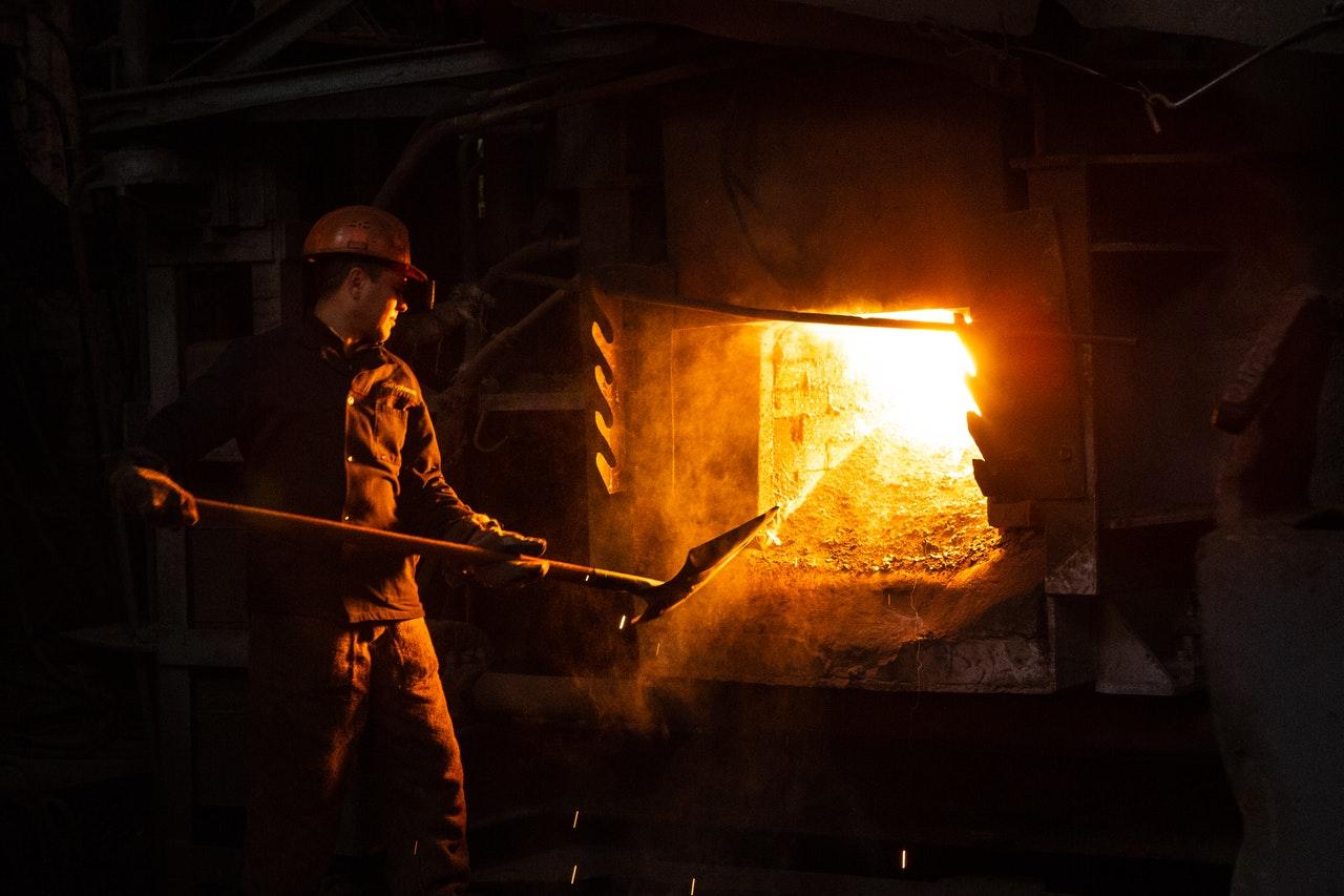 employee working on metal